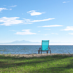 Beach chair facing the sea | Alkyóna Beach